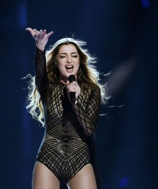 """Armenia's Iveta Mukuchyan rehearses the song """"LoveWave"""" during the jury show at the Ericsson Globe Arena in Stockholm, Sweden, Monday May 9, 2016. The Eurovision Song Contest 2016 starts with the first semifinal on Tuesday May 10. (Maja Suslin / TT via AP) SWEDEN OUT"""