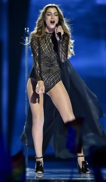 Armenia's Iveta Mukuchyan performs 'LoveWave' during the first Eurovision Song Contest semifinal in Stockholm, Sweden, Tuesday, May 10, 2016. (AP Photo/Martin Meissner)