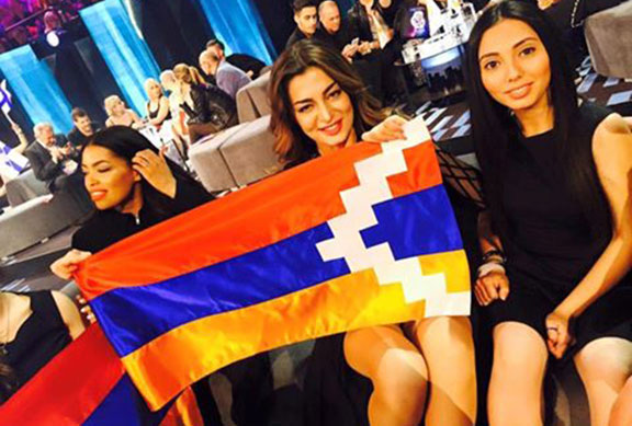 Iveta-Mukuchyan-displays-the-Artsakh-flag-during-a-Eurovision-press-conference